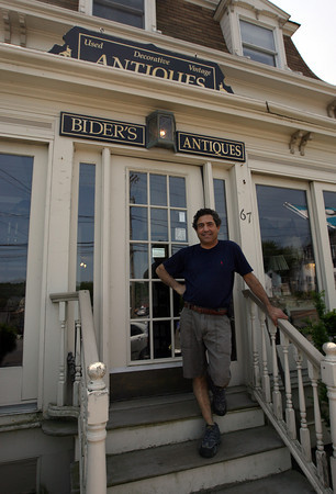 Michael Bider, owner of Bider's Antiques in Essex, sells some of his merchandise online in addition to regular retail sales. Photo by Kate Glass/Gloucester Daily Times