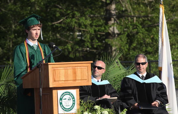 Salutatorian William Curatolo addresses the crowd gathered for the Manchester Essex Regional High School graduation ceremony yesterday evening as Principal Jim Lee and Vice Principal Paul Murphy look on. Photo by Kate Glass/Gloucester Daily Times