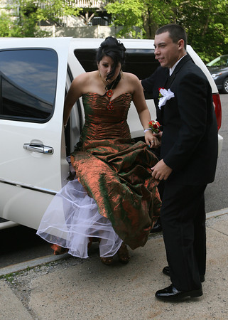 Matt Silva helps his date, Kristina Bandoni, out of the limo for the Gloucester High School Promenade last night. Photo by Kate Glass/Gloucester Daily Times