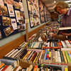 Betty Nicastro organizes the selection of hardcoer fiction books for the Sawyer Free Library's annual book sale, which runs Friday through Sunday in the Friend Room. Photo by Kate Glass/Gloucester Daily Times