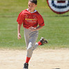 Gloucester:  Cardinals Lucas Cornett 11, runs the bases in the Road Runner compatition, Saturday morning at the Little Leauge Home Run Durby at Boudreau Field. The compation is like a relay, with a runner running all the bases and tagging another player standing at home plate. The team with the best time wins.  Desi Smith/Gloucester Daily Times.