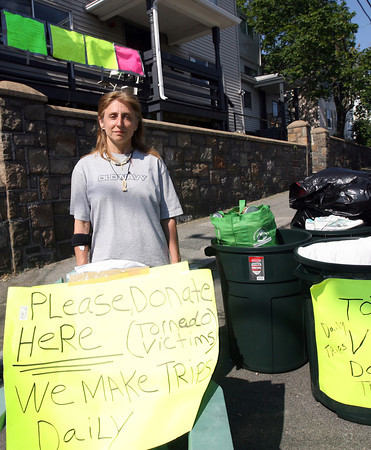 Diana Dietzel has set up collection bins outside her home on Prospect Street so people can drop items off to donate to victims of the tornadoes that went through the Springfield area last week. She has already made several trips to the area and plans to return later this week. Photo by Kate Glass/Gloucester Daily Times