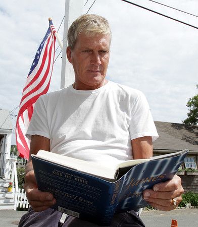 David Le/Gloucester Daily Times. Jack Byrd, owner of The Bearskin Neck Motor Lodge sits outside on his front porch and enjoys the beautiful weather on Tuesday afternoon. 6/28/11.