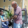 Rockport: Attorney Bill Marotta hands his wife Clair Chives plant she just bought at the Rockport Garden Club Plant Sale held Saturday morning at the Rockport Community House. Clair who's a retired culinary arts teacher chose the chive plant for its eatable flowers that she would spinkle over a salad,and the chives for other recipes.  Desi Smith/Gloucester Daily Times.