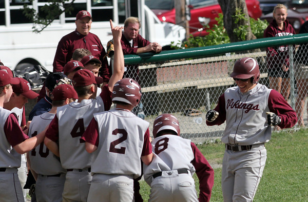 Rockport: Keady Segal's teammates greet him at home plate after he hit a home run in the 6th inning of their game against Matignon during the first round of the MIAA Division 4 North baseball championship at Evans Field yesterday. Matignon won the game 4-2. Photo by Kate Glass/Gloucester Daily Times