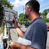 David Le/Gloucester Daily Times. Caleb Stone, of Rockport, sits across from Bearskin Neck and paints on a warm Wednesday afternoon. 6/29/11.