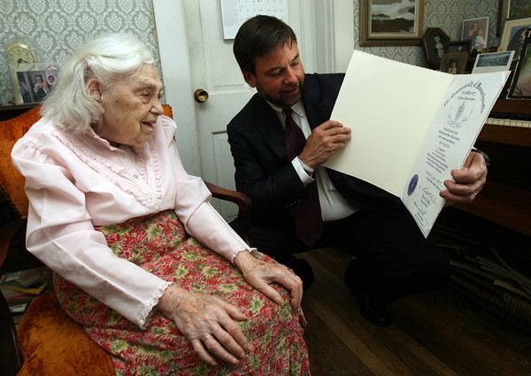 Thomas Riley, President of Seniorlink, presents Irma Sullivan of Gloucester with a citation from State Rep. Ann-Margaret Ferrante in celebration of Irma's 100th birthday at her home in East Gloucester yesterday. Photo by Kate Glass/Gloucester Daily Times