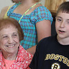 Gerri Lovasco smiles as Troy Edmonds, a member of the Rockport Elementary School Chorus, performs at the Rose Baker Senior Center on Friday morning. The kids performed many of the seniors' favorite songs and invited them to sing along. Photo by Kate Glass/Gloucester Daily Times