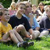 "David Le/Gloucester Daily Times. From left, Edward Merc, 5, of Rockport, and brothers Sean, 9, Steven, 10, and Scott Brown, 11, sit in the front row for the Sky Pirate Show at Millbrook Meadow Park in Rockport on Wednesday afternoon put on by Captain Robbie Bones, also known as ""Awesome"" Robb Preskins. 6/29/11."