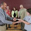 Rockport Elementary School Principal Shawn Maguire accepts a check from Ben Adams, the treasurer of Rockport Rotary's EarlyAct program as Rotarians Chaz Kreis, Laurene Wessel, and Jack Reed look on. The EarlyAct students raised $644 through a basketball game featuring students vs Rotary members. The money will be used to purchase playground equipment for the school and possible a picnic table. Photo by Kate Glass/Gloucester Daily Times