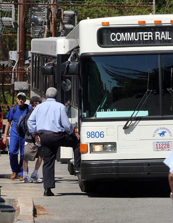 Commuters board shuttle buses at the West Gloucester Commuter Rail Station yesterday as work on the Annisquam River railroad bridge has suspended train service between West Gloucester and Rockport. Photo by Kate Glass/Gloucester Daily Times
