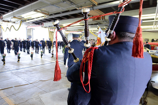 Gloucester:  Jeff Romeo plays taps on his bagpipes during Sundays Memorial Service held at Central Fire Station. Desi Smith/Gloucester Daily Times. June 12,2011