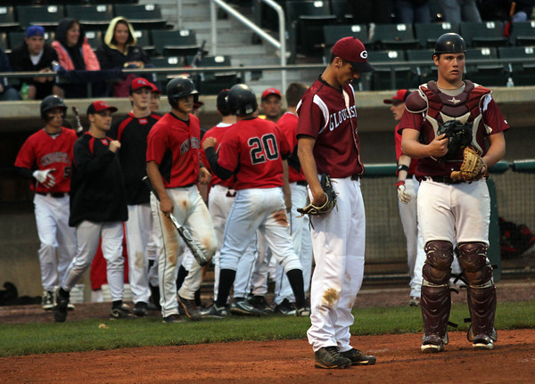 Lowell: Gloucester pitcher Adam Philpott and catcher Michael Muniz stand in shock after North Andover scores during the Division 2 North Semi Finals at LeLacheur Park in Lowell on Saturday night North Andover won 3-0. Photo by Kate Glass