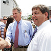 David Le/Gloucester Times. Massachusetts State Senator Scott Brown, left, and Senator Bruce Tarr, right, greet and talk with parade spectators on Sunday afternoon during the Fiesta Parade. 6/25/11.