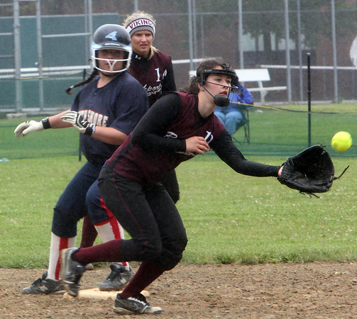 ALLEGRA BOVERMAN/Staff photo. Gloucester Daily Times. Rockport: Rockport's Gabby Muniz, front right, and Amanda Chalmers, behind her, right, in action at second base against North Shore Tech's Christina Cafiso during their game on Sunday in Rockport.