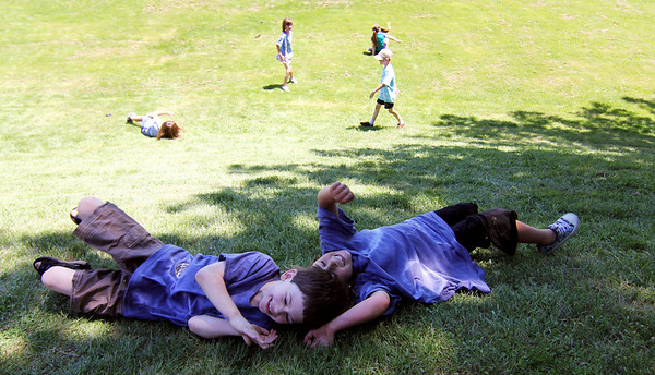 ALLEGRA BOVERMAN/Staff photo. Gloucester Daily Times. Essex: During the Annual Root Beer Float Day at the T.O.H.P. Library in Essex sponsored by the Friends of the Library, kids were playing outside, too, including, from left, pals  Kevin Adams, 6, and Abygayle Whittemore, 7.
