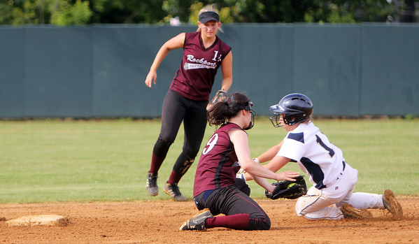 ALLEGRA BOVERMAN/Staff photo. Gloucester Daily Times.  Lowell: Rockport's <br /> Gabby Muniz, front center, and Amanda Chalmers, left,  try to St. Mary's Victoria Viger out at second base during their game in the Division III North Semifinals held in Lowell on Friday afternoon.