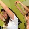 ALLEGRA BOVERMAN/Staff photo. Gloucester Daily Times. Gloucester: Rehearsing their dance for the upcoming talent show are Gloucester Community Arts Charter School seventh graders Michelle Puccio, left, and Olivia Frances. There are 27 acts - students and teachers are participating - for the talent show, which will be held on Wed. June 6 from 7-8:30 p.m in the school gymnasium.
