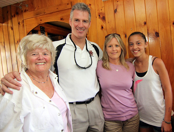 ALLEGRA BOVERMAN/Staff photo. Gloucester Daily Times. Gloucester: U.S. Sen. Scott Brown, center, with Mary Stewart of Lynnfield, left, and Susan and Lindsay LeClaire of Danvers during his visit to Lobsta Land in Gloucester on Saturday.