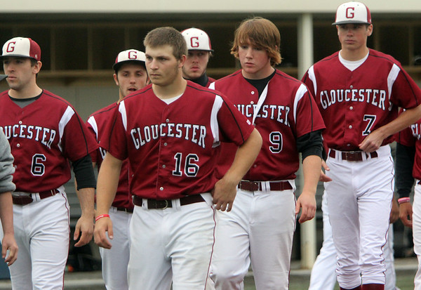 ALLEGRA BOVERMAN/Staff photo. Gloucester Daily Times. Salem: Gloucester players walk off the field after their 5-1 loss to Beverly at Salem State University on Tuesday afternoon. From left, in front, are: Vincenzo Taormina, Logan Horne, Peter Clark and Sean Gillon.
