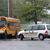 ALLEGRA BOVERMAN/Staff photo. Gloucester Daily Times. Gloucester: Gloucester's Animal Control Officer Jamie Levie was looking at the school bus parking area at the Fuller Middle School complex on Wednesday after there was a report of coyotes in the area of the buses.