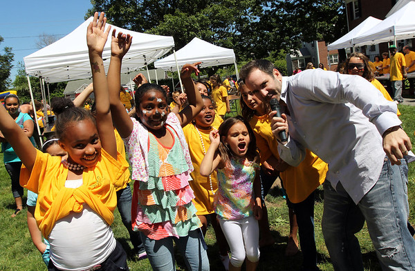 ALLEGRA BOVERMAN/Staff photo. Gloucester Daily Times. Gloucester: DJ Johnny Kelly dances up a storm with the participating kids during the Open Door Food Pantry Summer Lunch program held at Riverdale Park on Veterans Way on Friday afternoon.