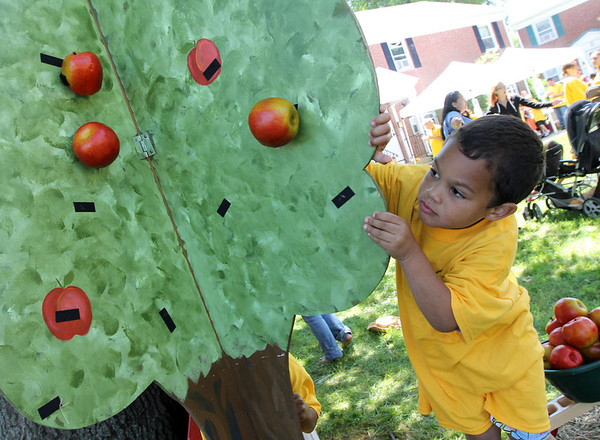 ALLEGRA BOVERMAN/Staff photo. Gloucester Daily Times. Gloucester: <br /> Jermaine Smith, 3, plays in a farm-themed play area after eating lunch with his mom, Sarah Rogers, during the Open Door Food Pantry Summer Lunch program held at Riverdale Park on Veterans Way on Friday afternoon.