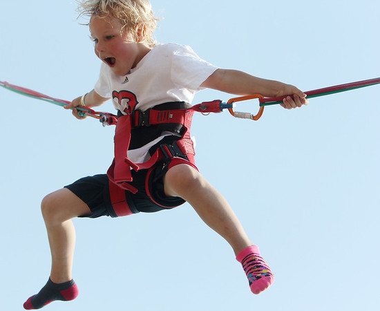 "ALLEGRA BOVERMAN/Staff photo. Gloucester Daily Times. Gloucester: Lucas Howlett, 6, of Gloucester, was enjoying the ""vertical reality"" bungee jump at the carnival at Fiesta on Friday afternoon."