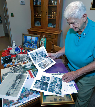 Gloucester: Sara Favazza looks through some of her Fiesta Memorabilia and photographs at her home in Gloucester. JIm Vaiknoras/staff photo