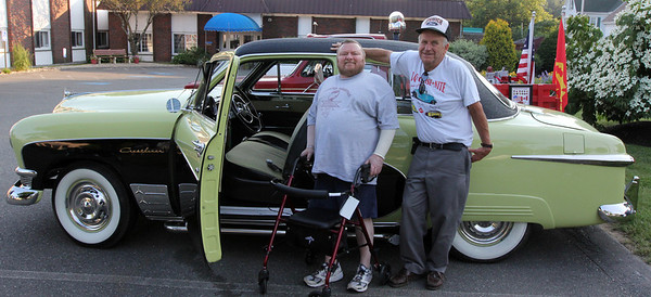 ALLEGRA BOVERMAN/Staff photo. Gloucester Daily Times. Gloucester: <br /> Larry Cusolito, left, a resident of Golden Living Center, leans jauntily with Don Smith of Rockport against Smith's 1950 Ford Crestliner during the <br /> Golden Living Center's annual classic car show on Thursday evening. About 15 classic vehicles were on display.