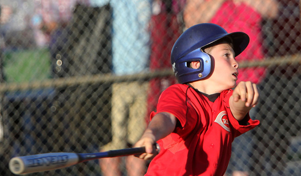 Allegra Boverman/Staff photographer. Gloucester Daily Times. Gloucester:<br /> Marcus Montagnino of the Reds participates in the 9-year-old portion of the home run derby during the Seventh Annual Gloucester Little League Family Picnic and Skills night held at Boudreau Field on Friday evening.