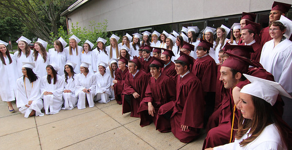 ALLEGRA BOVERMAN/Staff photo. Gloucester Daily Times. Rockport: Members of the Rockport High School Class of 2012 pose together spontaneously before commencement on Friday evening at the school.