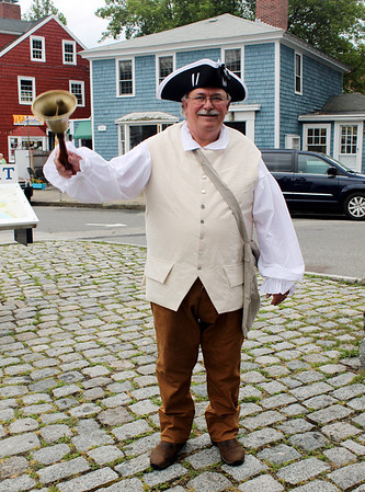 Gail McCarthy/Staff photographer. Rockport: Chuck Francis, in the role of town crier, rings the bell to call townspeople and visitors to Dock Square for the reading of the Declaration of Independence. On July 4 at 10 a.m., the Rockport Rotary Club will present a reading of the historic document,.