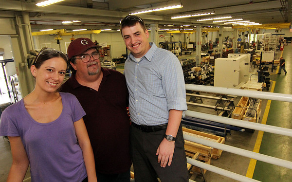 ALLEGRA BOVERMAN/Staff photo. Gloucester Daily Times. Gloucester: Members of the Marchant Family of Gloucester work at Gloucester Engineering. From left are Alicia Marchant, a CNC programmer, Jim Marchant, a building and machine repair technician, and Jimmy Marchant, Jr. a staff accountant.