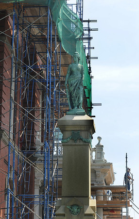 Gloucester: A worker looks out front of Gloucester City Hall during the building extensive renovations. Jim Vaiknoras/staff photo