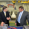 ALLEGRA BOVERMAN/Staff photo. Gloucester Daily Times. Gloucester: Gloucester Engineering Vice President of Project Management Lloyd Rothaus, right, talks with Sen. Bruce Tarr about the products they make in their Gloucester plant on Friday morning.