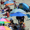 ALLEGRA BOVERMAN/Staff photo. Gloucester Daily Times. Rockport: Colorful umbrellas filled Front Beach in Rockport with shade on Friday afternoon.