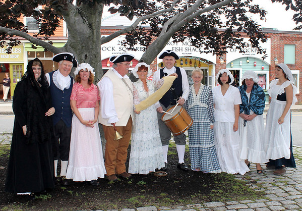 Gail McCarthy/Staff photographer. Rockport: Members of the Rockport Rotary Club will be taking part in the July 4th reading of the Declaration of Independence at 10 a.m. in Dock Square downtown.  From left are:  Barbara Ellis. Bob Ellis. Janelle Favaloro, Chuck Francis,Daphne Congelosi, Andrew Maddox, Kate Favaloro, Rina Takahashi (Rotary exchange student) Laurene Wessel (new Rotary president) and Angela Cook.