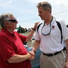 ALLEGRA BOVERMAN/Staff photo. Gloucester Daily Times. Gloucester: U.S. Sen. Scott Brown, right, and former seven-term Democratic State Rep. Tony Verga had lunch with other local leaders at Lobsta Land in Gloucester on Saturday. Verga has endorsed Brown.