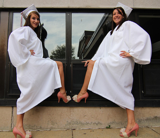 ALLEGRA BOVERMAN/Staff photo. Gloucester Daily Times. Rockport: Best friends Marabah Akers, left, and Kendra Adams dressed identically, from their shoes on up to white dresses for Rockport High School's commencement on Friday evening at the school. Akers will attend San Diego State for nursing and Adams will attend North Shore for psychology in the fall.