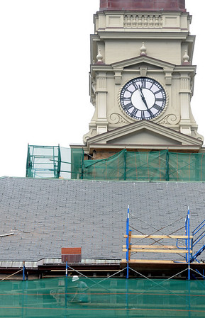 Gloucester: A worker moves along a maze of scaffolding on Gloucester City Hall. Jim Vaiknoras/staff photo