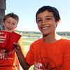 ALLEGRA BOVERMAN/Staff photo. Gloucester Daily Times. Essex: During the Annual Root Beer Float Day at the T.O.H.P. Library in Essex sponsored by the Friends of the Library, Evan Fitzgerald, left, 11, and Kendall Hersey, 10, right, clink their root beer float cups together in celebration of the last day of school.