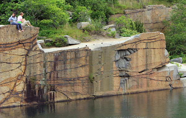 ALLEGRA BOVERMAN/Staff photo. Gloucester Daily Times. Rockport: People relax at Babson Quarry inside Halibut Point State Park on Tuesday afternoon.