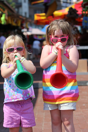 ALLEGRA BOVERMAN/Staff photo. Gloucester Daily Times. Gloucester: From left, sisters Madison Lord, 3, and Olivia Lord, 5, both of Gloucester, make some noise at the carnival at Fiesta on Friday afternoon.