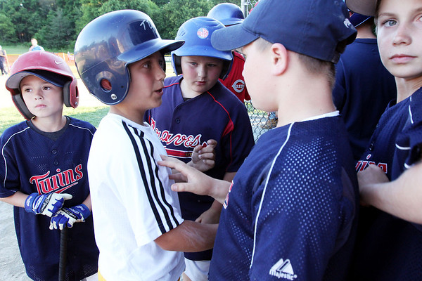 Allegra Boverman/Staff photographer. Gloucester Daily Times. Gloucester:<br /> Tucker Destino, second from left, is congratulated by other Little League players after he participated in the 9-year-old portion of the home run derby during the Seventh Annual Gloucester Little League Family Picnic and Skills night held at Boudreau Field on Friday evening. From left around him are: Brett Gaipo, Josh Concors, who ended up scoring five home runs, Zach Abbott, who also ended up scoring five home runs, and Emmett Caldwell.