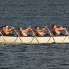 Gloucester: One of the crews racing in the Nina rows in unison at the Seine boat eliminations on Pavilion Beach Wednesday night. Jim Vaiknoras/staff photo