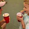 ALLEGRA BOVERMAN/Staff photo. Gloucester Daily Times. Essex: During the Annual Root Beer Float Day at the T.O.H.P. Library in Essex sponsored by the Friends of the Library, Dennis Pyburn, left, and his son Kenneth Pyburn, 6, enjoy root beer floats, Kenneth trying his for the first time.