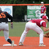 ALLEGRA BOVERMAN/Staff photo. Gloucester Daily Times. Salem: <br /> Beverly's Harry Brown, left, and Gloucester's Lenny Zappa in action at second base during their game held at Salem State University on Tuesday afternoon.