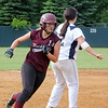 ALLEGRA BOVERMAN/Staff photo. Gloucester Daily Times.  Lowell: Rockport's Amanda Chalmers, left, rounds third base during their game against St. Mary's in the Division III North Semifinals held in Lowell on Friday afternoon.