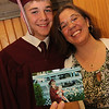 ALLEGRA BOVERMAN/Staff photo. Gloucester Daily Times. Rockport: <br /> Cameron Brousseau, left, and his mother Tanya Brousseau at  Rockport High School's commencement on Friday evening at the school. She is showing a photo of herself at her RHS graduation in 1995 at age 18 with Cameron, age 10 months. Now she's with him at his  graduation.